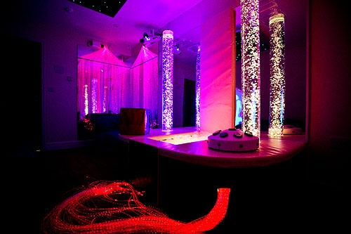 The darkened multisensory room with light and colour effects did not create any interest for visual awareness reactions for Ali, even with one stimulus at a time.