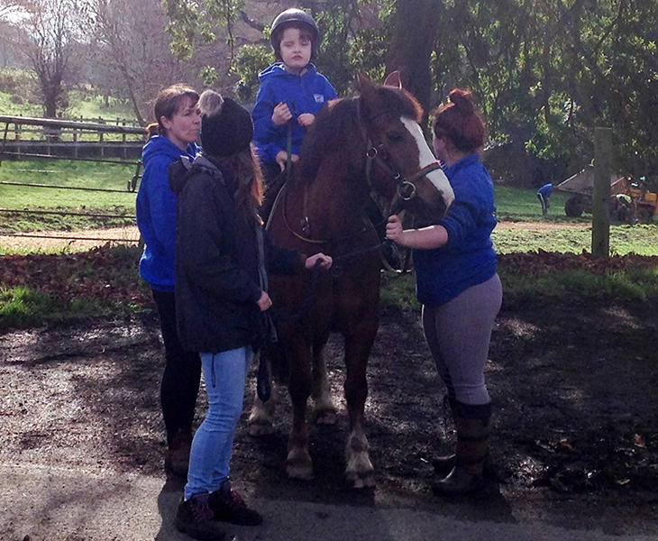 Photos that parents have sent us of their child with CVI enjoying horse riding
