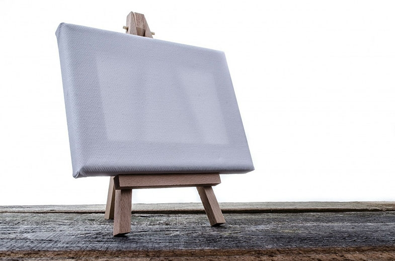 An adjustable table top artist's easel could be used to elevate a book or work, to a higher level on a desk, where people with lower visual field impairments can see most clearly.