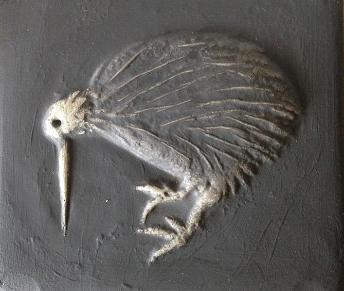 tile with grey kiwi bird engraved