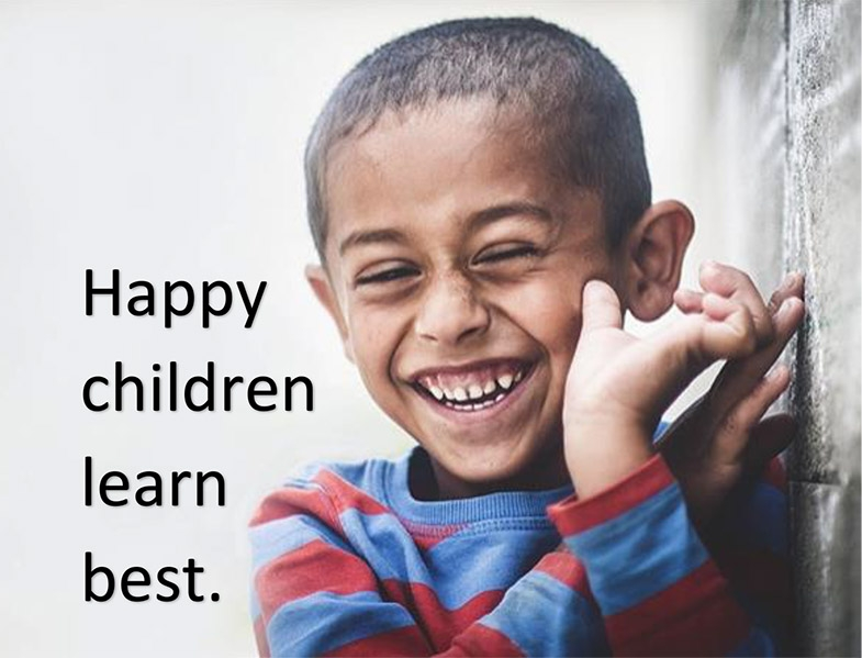 photo of a smiling child with the words happy children learn best